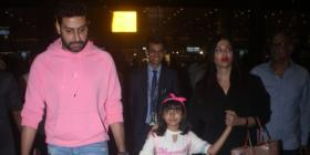 PHOTOS: Abhishek Bachchan & Aishwarya Rai Bachchan arrive at the airport with daughter Aaradhya
