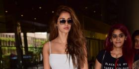 PHOTOS: Disha Patani looks oh so chic in an all white look as she gets papped at the airport