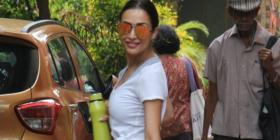 PHOTOS: Malaika Arora dons a white tee with shorts for her workout session and styles it up with sunnies