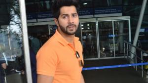 PHOTOS: Varun Dhawan looks suave as he matches an orange tee with white jeans & gets papped at the airport