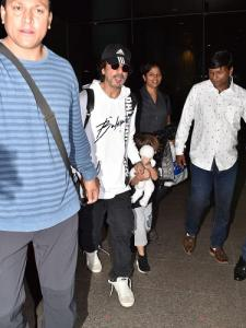 Photos: Shah Rukh Khan papped at the airport with AbRam as the little one tries hard to hide his face