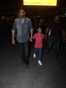 Airport Diaries: Ajay Devgn is all smiles as he arrives with his son Yug Devgn; View Picture