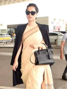 PHOTOS: When Kangana Ranaut wore a Rs 600 saree & paired it with Givenchy trench coat and classic Prada bag