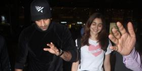 PHOTOS: Alia Bhatt is all smiles as she arrives at the airport with beau Ranbir Kapoor