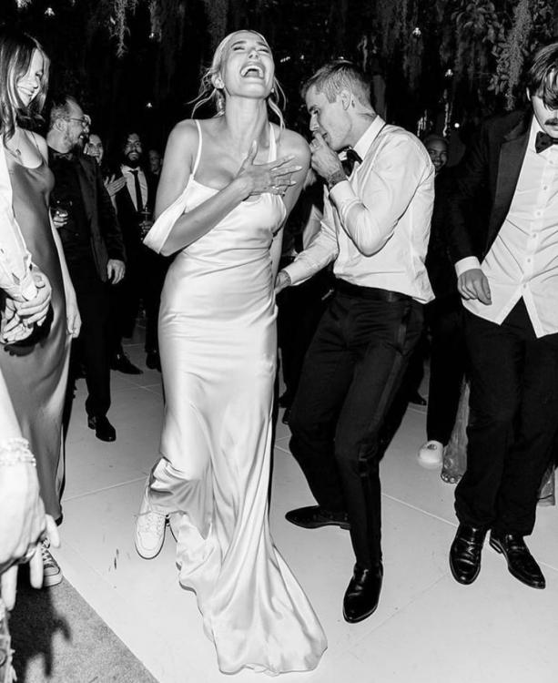 Hailey Bieber proves that she is the COOLEST BRIDE EVER as she pairs her custom Vera Wang dress with sneakers