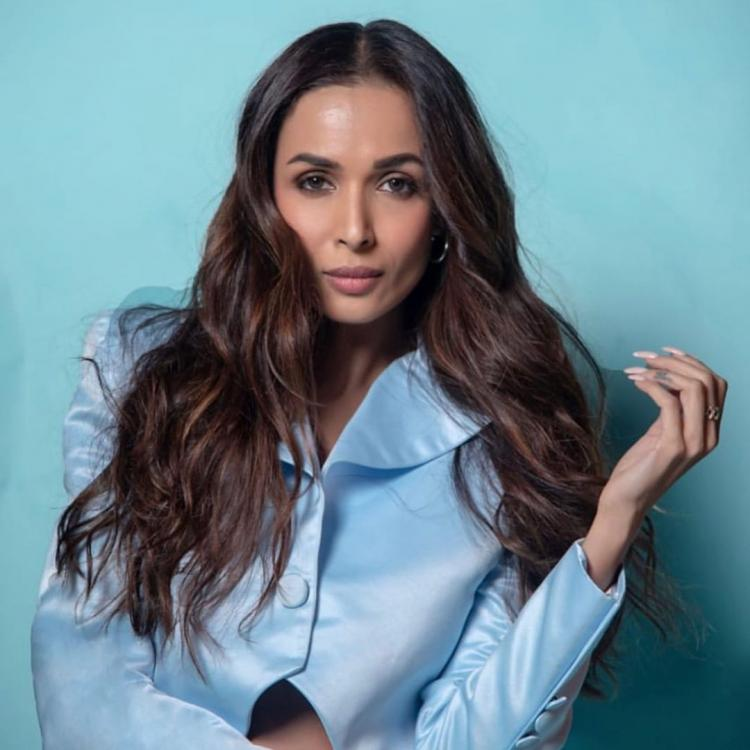 Malaika Arora makes a powerful statement in a powder blue pantsuit & it is perfect for your next office party