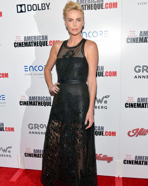 Charlize Theron says she loves her job; Here's why