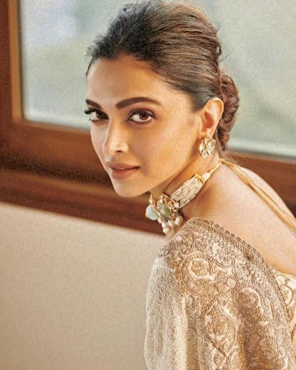 Deepika Padukone looks resplendent in an ivory saree and we cannot take our eyes off her: Yay or Nay?
