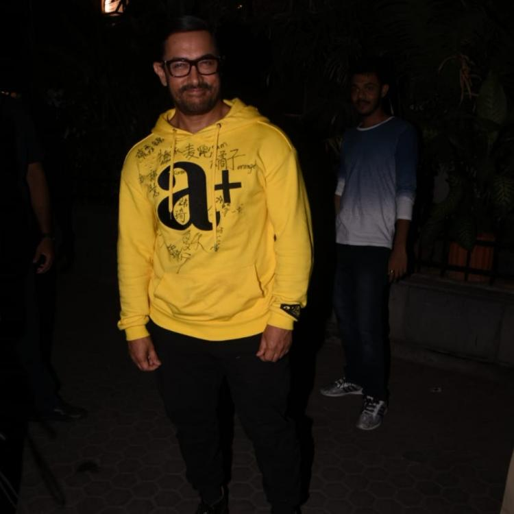PHOTOS: Aamir Khan is all smiles as he gets snapped while stepping out of a theatre
