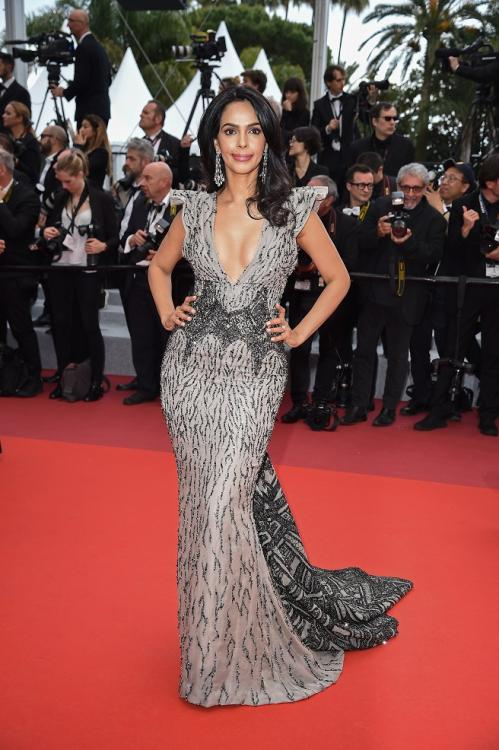 Cannes 2019: Mallika Sherawat walks the red carpet in an embellished, plunging neckline gown.