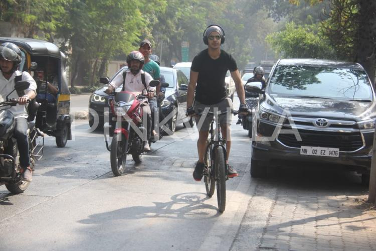 Ishaan Khatter poses for the paparazzi as he gets snapped while cycling on the streets of Mumbai