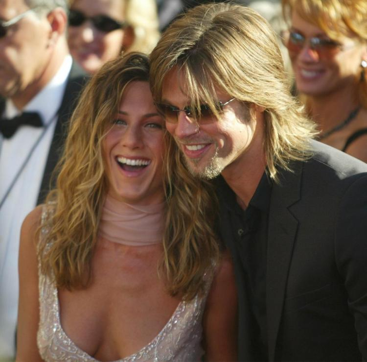Jennifer Aniston is not jealous of ex-husband Brad Pitt and Charlize Theron's dating rumours.