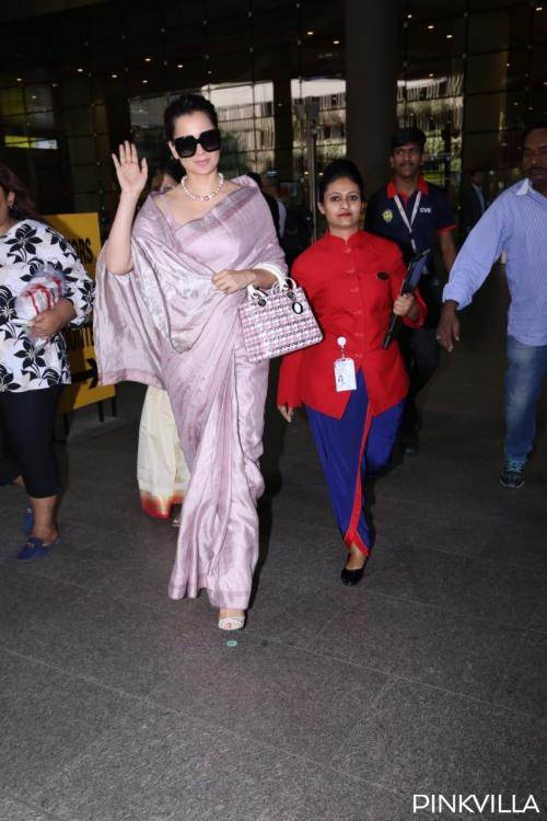 Photos: Kangana Ranaut stuns in a desi airport look wearing a purple saree