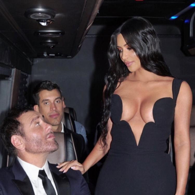 Kim Kardashian flaunts her cleavage in a daringly low cut black gown; see pics