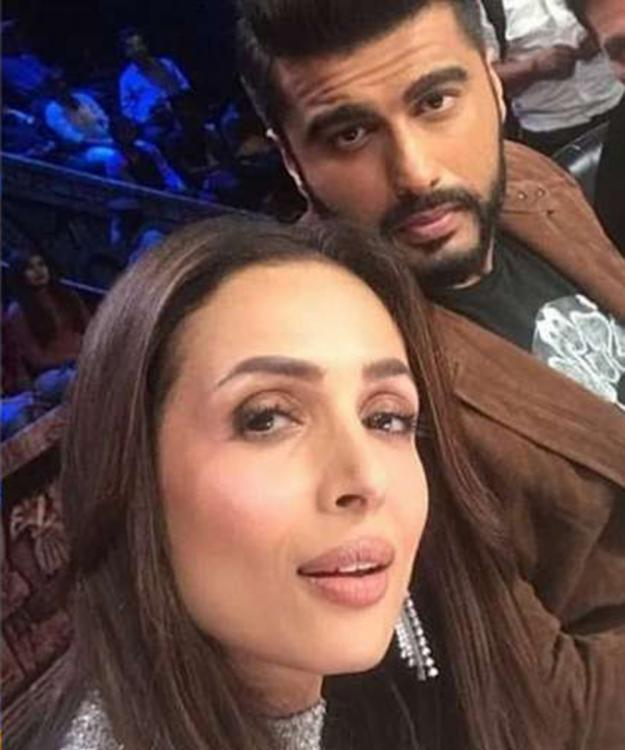 Arjun Kapoor leaves a curious reply on Malaika Arora's photo and we wonder if it hints at their Milan holiday?