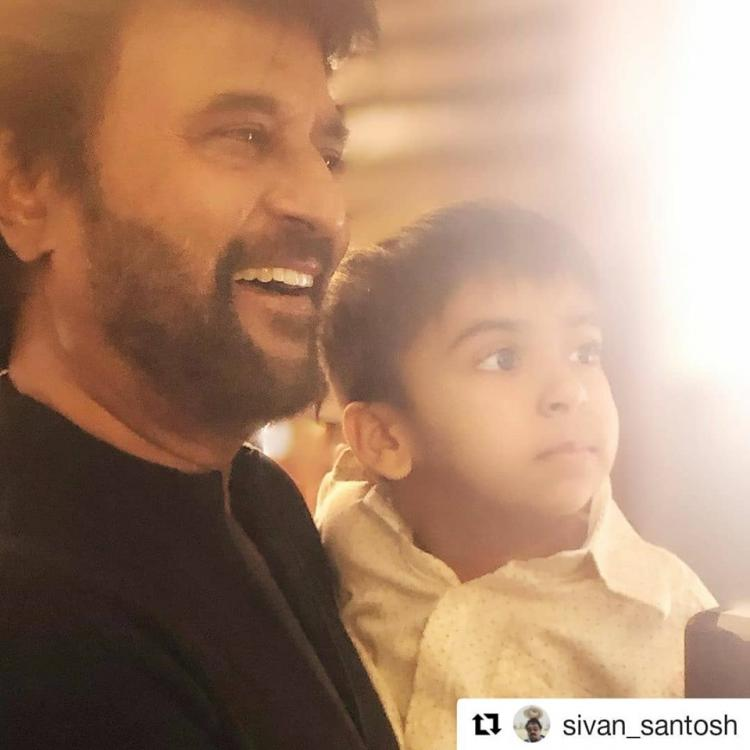 Rajinikanth gets captured in a priceless moment with his grandson on the sets of Darbar