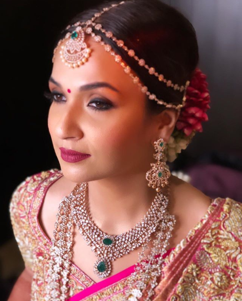 Bride Soundarya Rajinikanth looks elegant in Abu Jani Sandeep Khosla at her wedding with Vishagan Vanangamudi