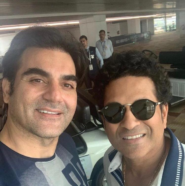 Sachin Tendulkar and Arbaaz Khan bump into each other at the airport & click a happy selfie; See post