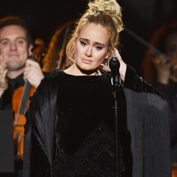 Songwriter Ryan Tedder says that singer Adele is in a good place after the difficult split from her husband