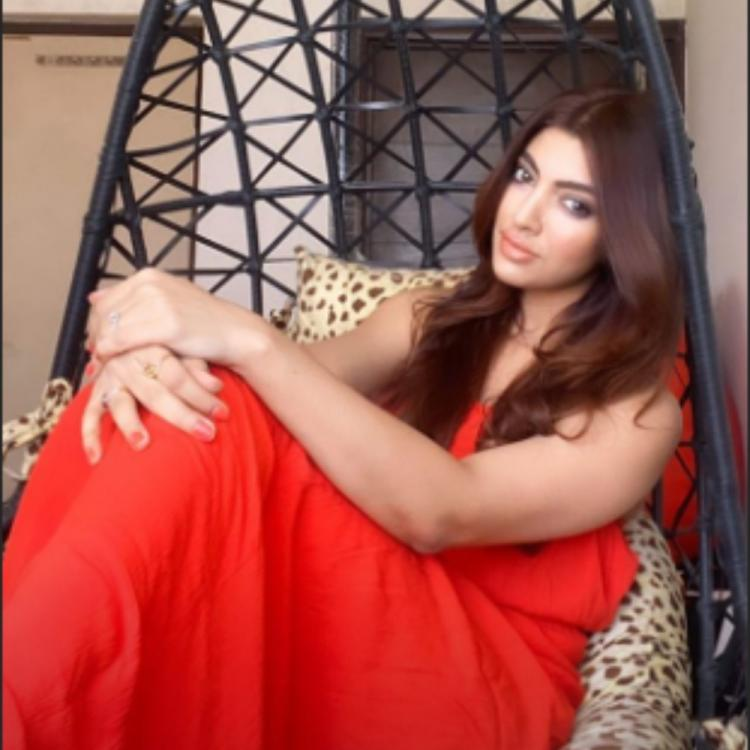 Akanksha Puri looks ravishing in a red outfit as she poses for a PHOTO while in quarantine