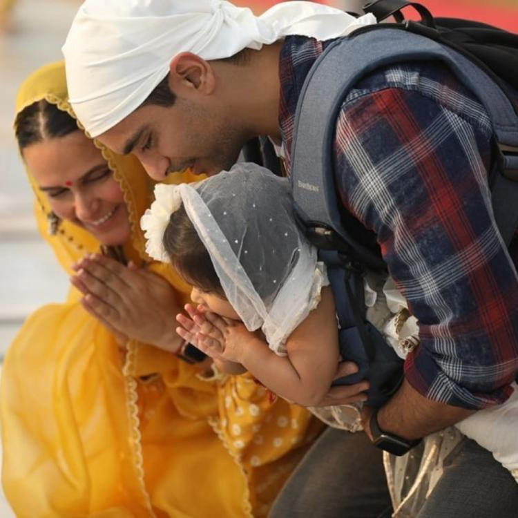Neha Dhupia and Angad Bedi seek blessings at the Golden Temple with their daughter Mehr; See Pics