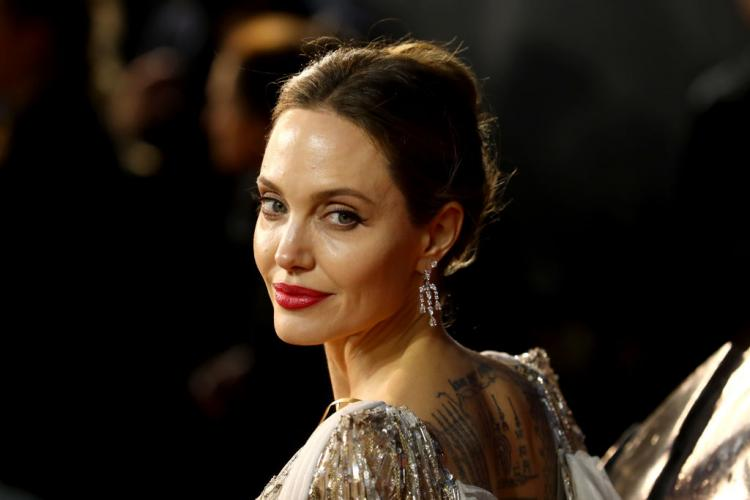 Angelina Jolie stuns in a silver princess Ralph and Russo gown at the London premiere of Maleficent