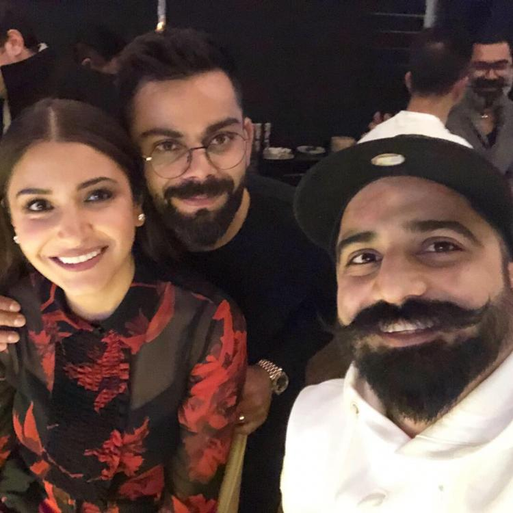 Anushka Sharma and Virat Kohli are all smiles as they dine out with a friend; view PIC