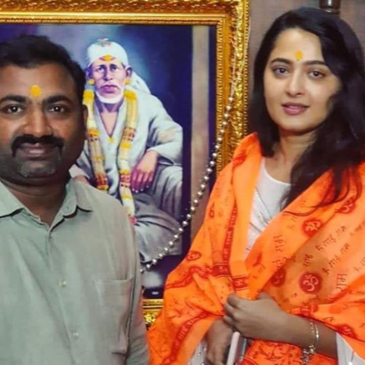 Anushka Shetty is an epitome of simplicity as she poses with a fan at Shirdi temple in this rare throwback PIC