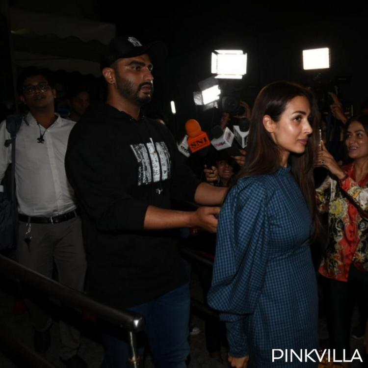 PHOTOS: Arjun Kapoor plays the protective boyfriend to Malaika Arora as they make way post IMW's screening