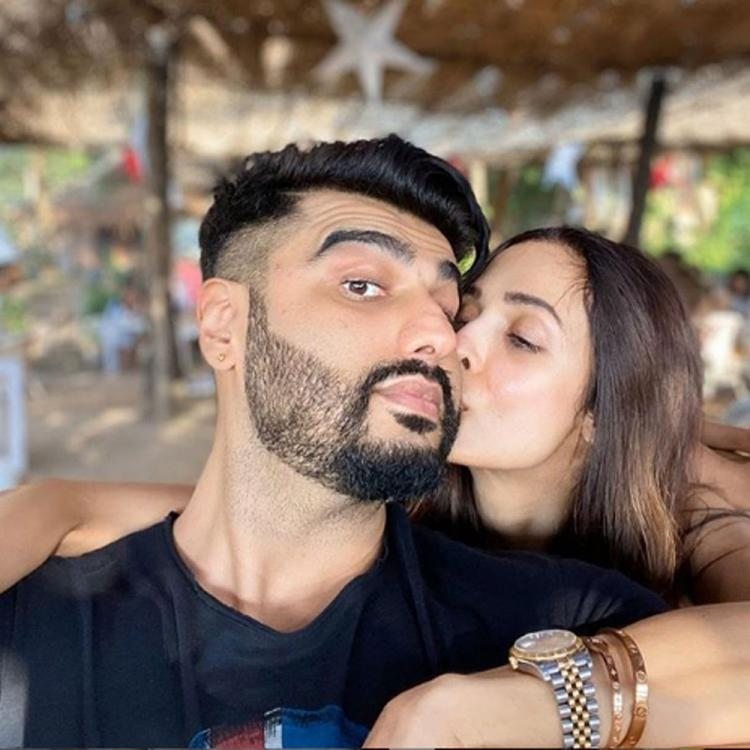 Arjun Kapoor and Malaika Arora seal the New Year with a sweet kiss and we're loving the PDA; View Photo
