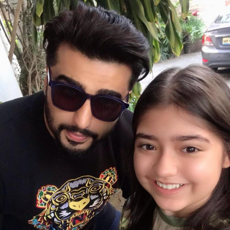 Arjun Kapoor is all smiles while posing for a selfie with a cute little fan of his; See pic