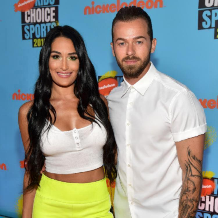 Artem Chigvintsev selects a ring for Nikki Bella and his reaction when he finds out the price is hilarious