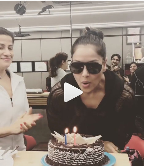 Bipasha Basu cuts her birthday cake with her trainer as the actress celebrates her 40th birthday today
