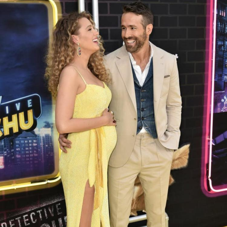 PHOTO: Pregnant Blake Lively cannot stop blushing as she hugs Ryan Reynolds on the sets of Free Guy