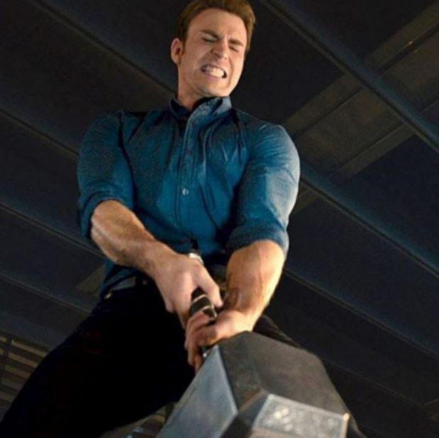 Chris Evans' Captain America trying to pull Thor's Hammer in Avengers: Age of Ultron
