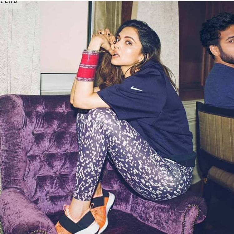 In this picture, Deepika Padukone is posing wearing a tee, jeggings and chura and we totally love it
