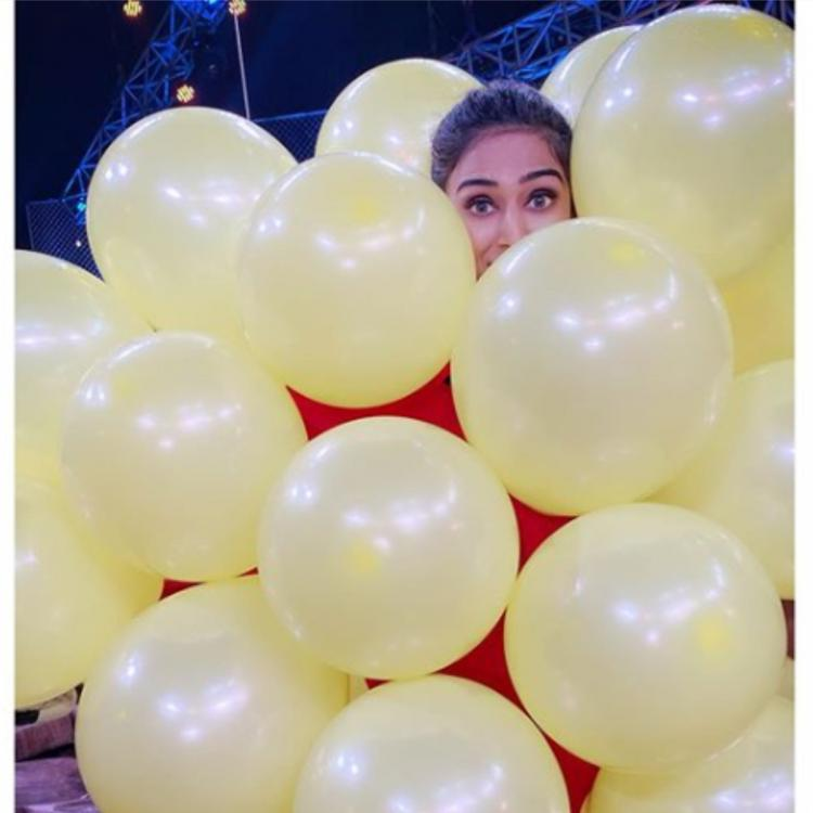 Kasautii Zindagii Kay actress Erica Fernandes is a happy balloon baby as she is buried in so many of them