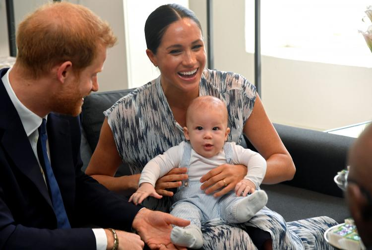 Smiling and playfully sitting on mum Meghan's lap, Archie Harrison melted scores of hearts and made royal fans go 'awww'.