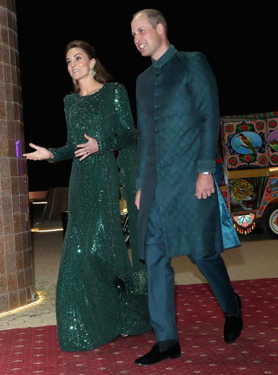 For the event, Kate and William colour co-ordinated in different shades of green as they arrived in a rickshaw.