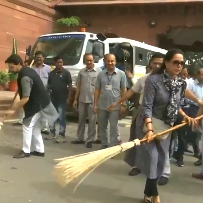 Hema Malini gets relentlessly TROLLED for her video of cleaning the road outside the Parliament; Check it out