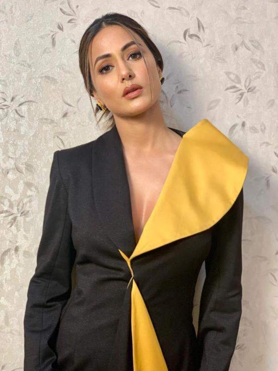 Hina Khan is a definition of a perfect modern woman as she pulls off a bold combination of black and yellow