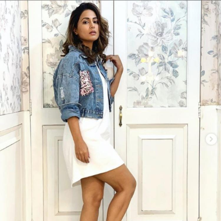 Hina Khan looks amazing as she styles her white dress with a denim jacket; View PICS