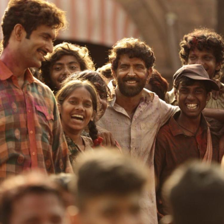 Super 30: Hrithik Roshan aka Anand Kumar flaunts his widest smile with his batch of students in a new still