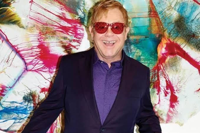 Elton John receives a special award 'Companion of Honour' in a music charity
