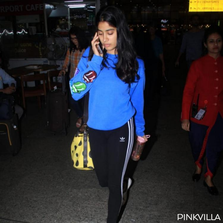 PHOTOS: It is phone o'clock for Janhvi Kapoor as she returns to Mumbai post an event in New Delhi