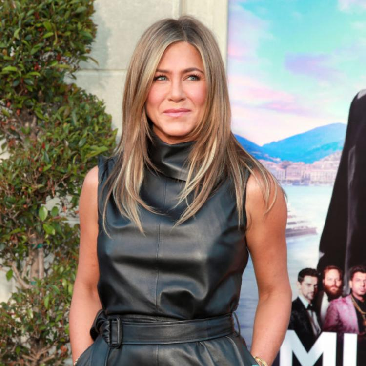 Jennifer Aniston stuns in a black leather dress as she attends the world premiere of Murder Mystery; View pics