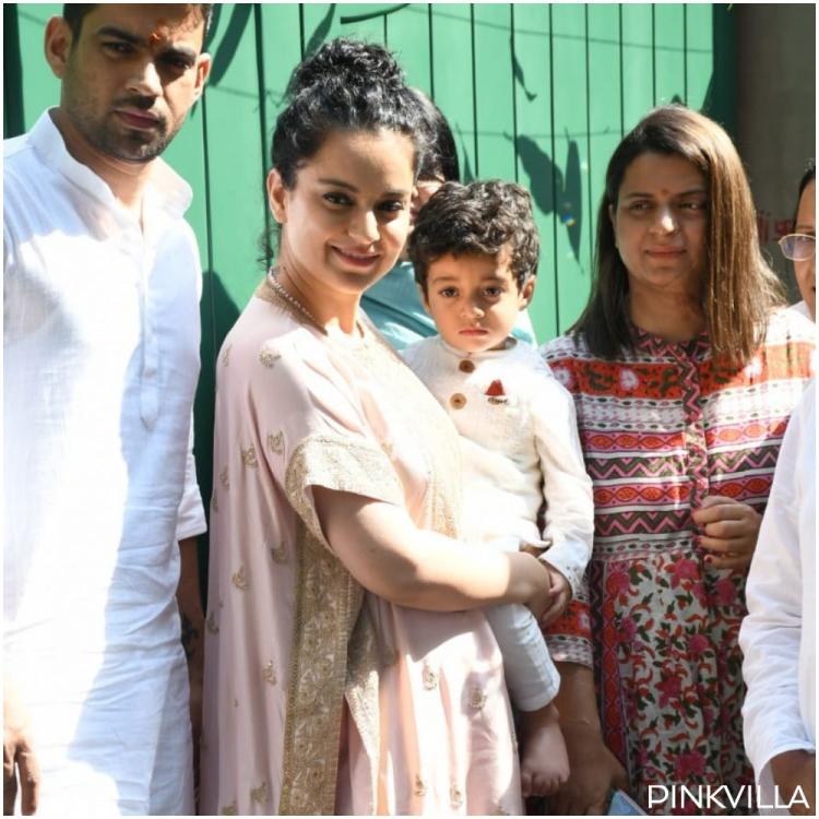 Kangana Ranaut holds her nephew Prithvi as she poses at the muhurat of her production house Manikarnika films