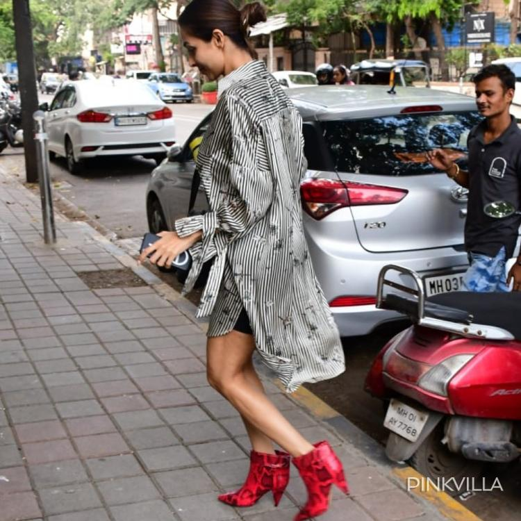Malaika Arora makes a perfect new age diva as she flaunts her red boots; Check out the pictures