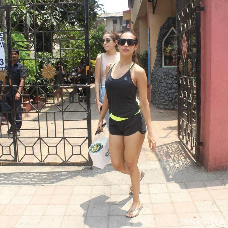 PHOTOS: Malaika Arora is defying age like a pro in cute black top & shorts as she gets snapped outside her gym