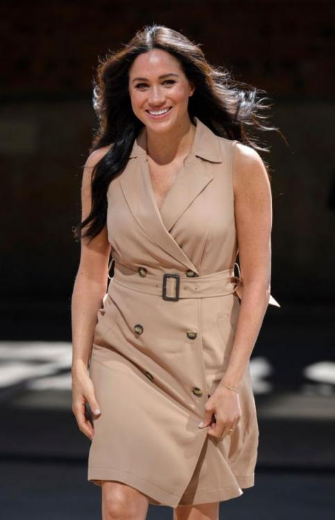 Meghan Markle opts for an affordable trench dress and avoids a fashion faux pas in Johannesburg
